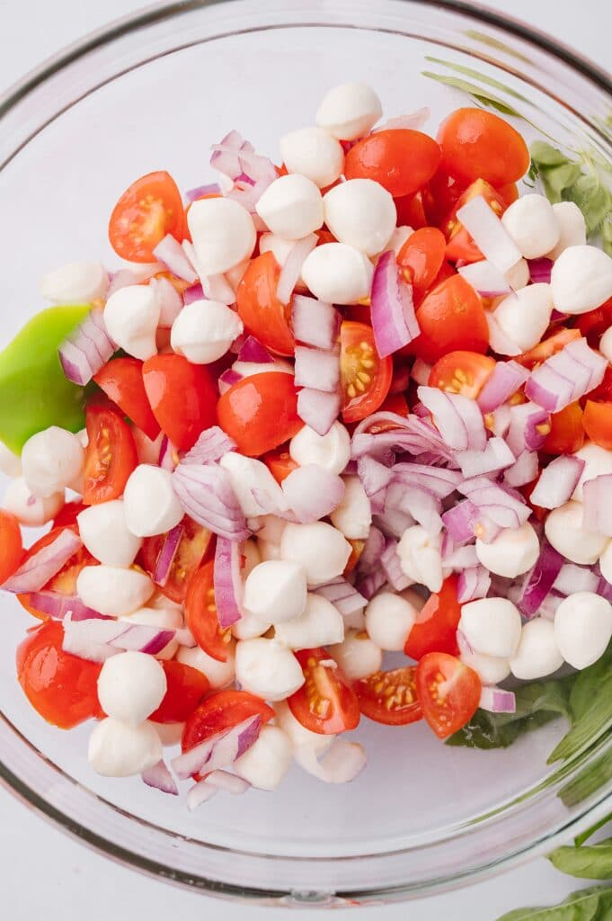 ingredients for caprese chicken in a bowl