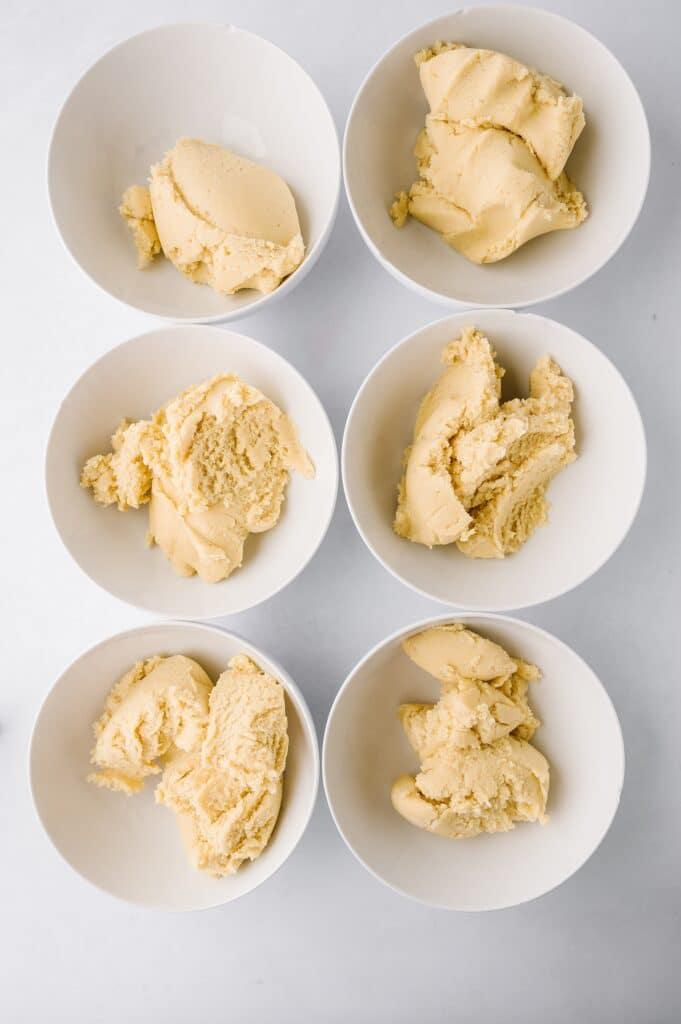 6 bowls of plain sugar cookie dough