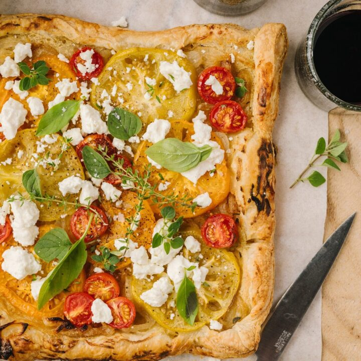 tomato and feta tart on parchment paper