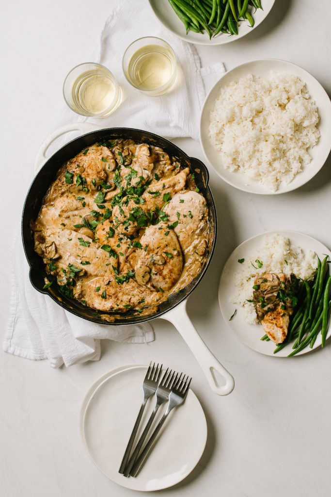 easy chicken dinner in skillet with rice and green beans on side with white wine