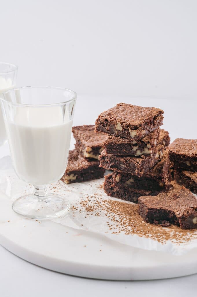 matt's crazy brownies on a plate with a glass of milk