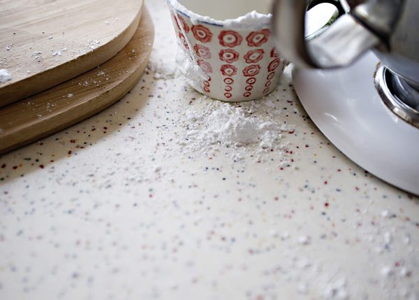 kitchen counter dusted with confectioner's sugar