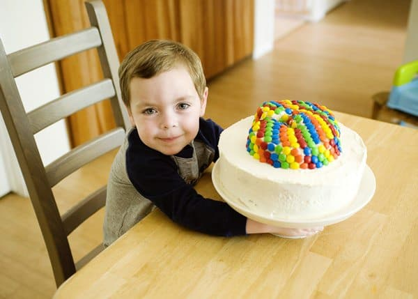 birthday cake topped with marshmallow buttercream frosting and M&Ms