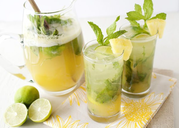 Pour over ice, and garnish with pineapple chunk, mint, and more limes.
