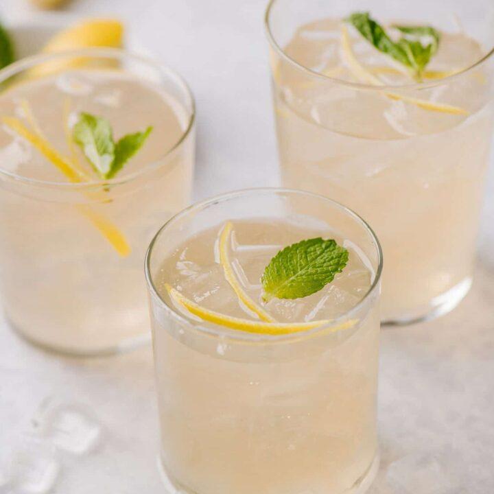 Elderflower smash cocktail with slices lemons in the background