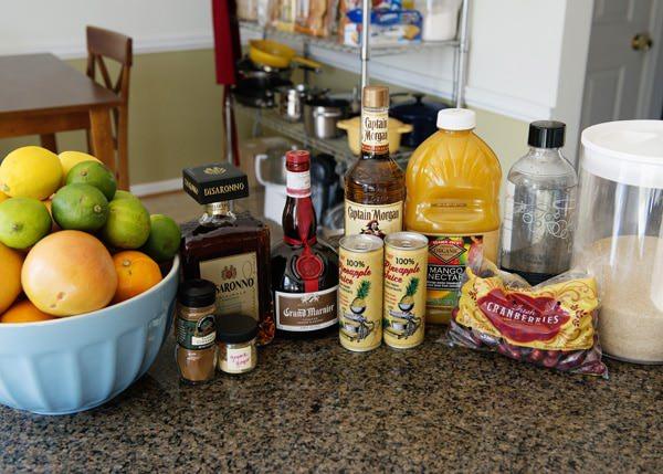 fresh citrus fruit, amaretto, grand marnier, captain morgan, juice, cranberries