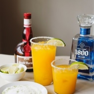 mango margarita on the rocks with lime salt sugar rim