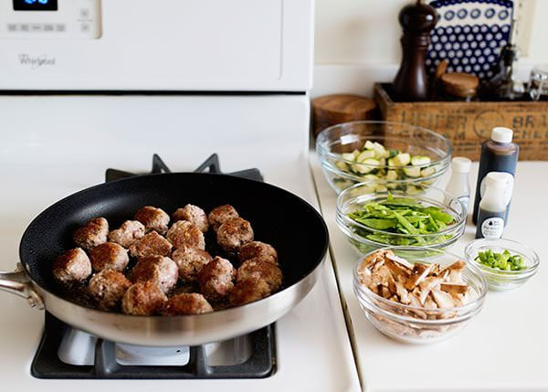 soy ginger pork meatballs with zucchini and snow pea fried rice