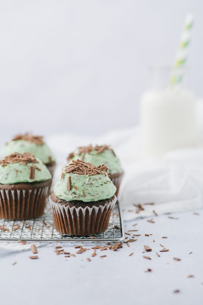 mint chocolate chip cupcakes and a bottle of milk