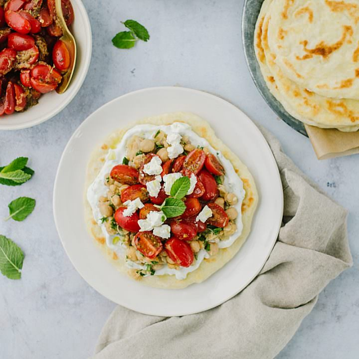 tomatoes and flatbread on a plate