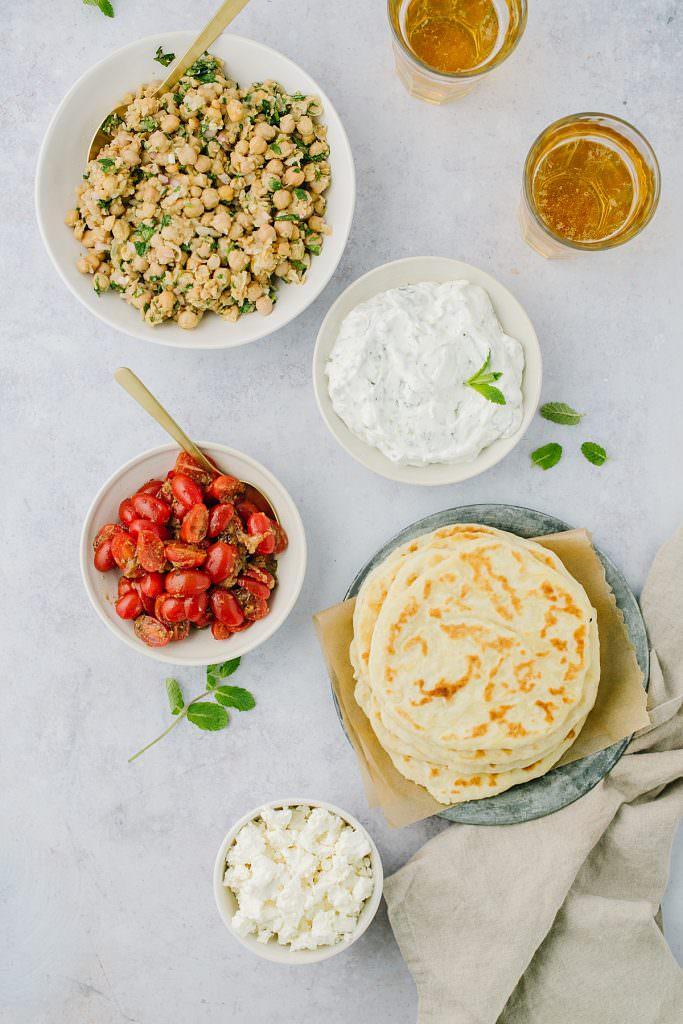 flatbread, yogurt sauce, marinated tomatoes, chickpeas