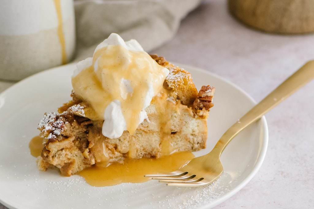 Pumpkin Bread Pudding on a plate with a gold fork