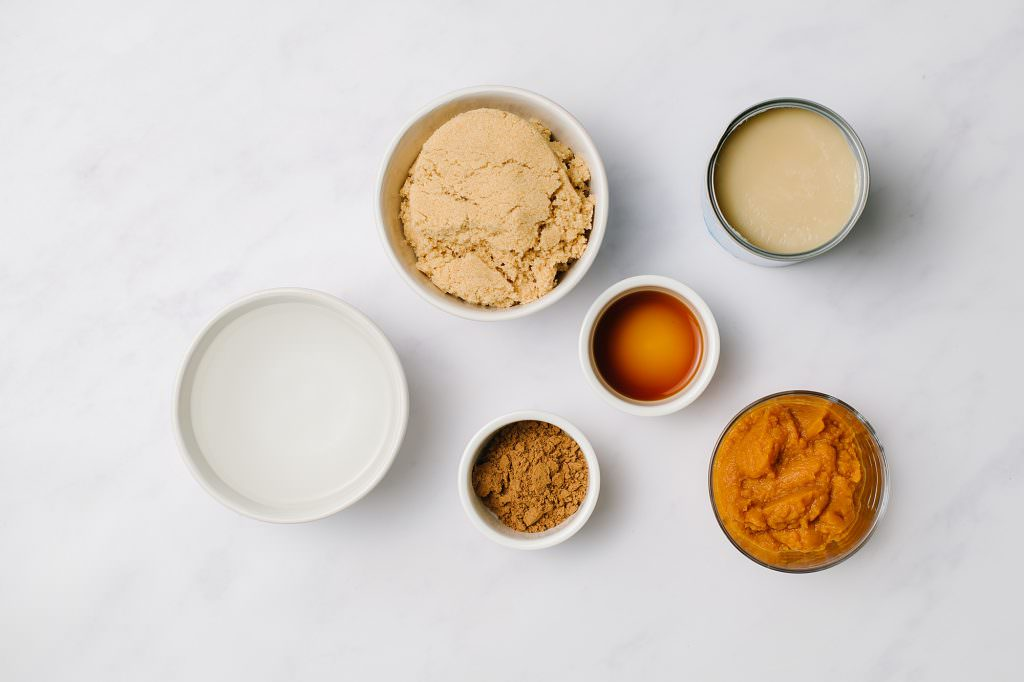 Pumpkin Spice Syrup ingredients in white bowls