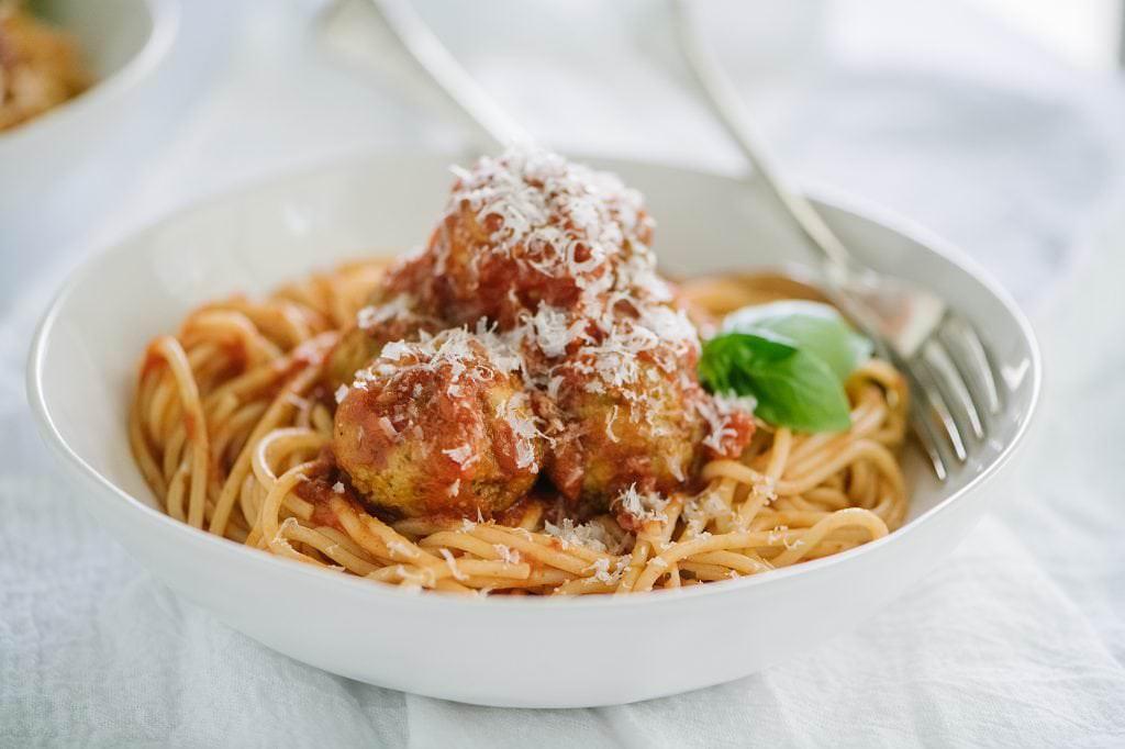 Bowl of spaghetti and pesto meatballs