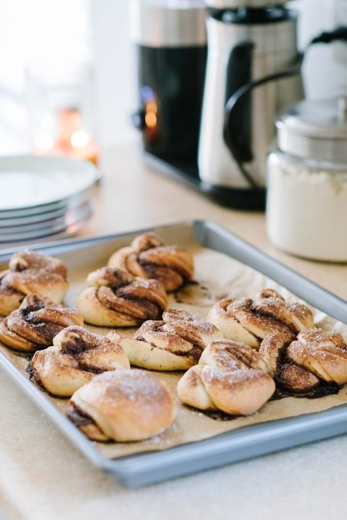 swedish cinnamon buns on a baking sheet
