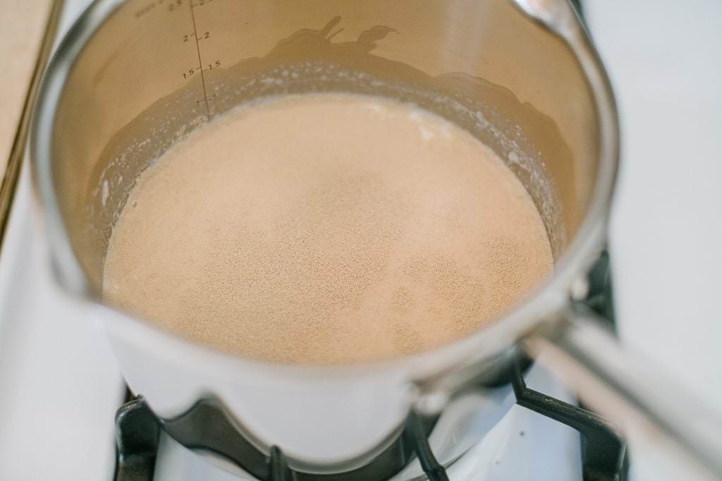 milk on the stove with yeast