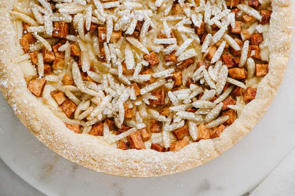 close up shot of apple almond cheesecake