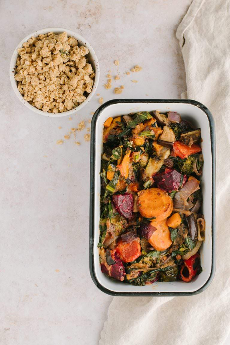pan of roasted vegetables and a dish of savory crumble for topping