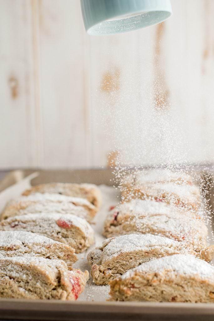 powdered sugar being dusted on stollen scones