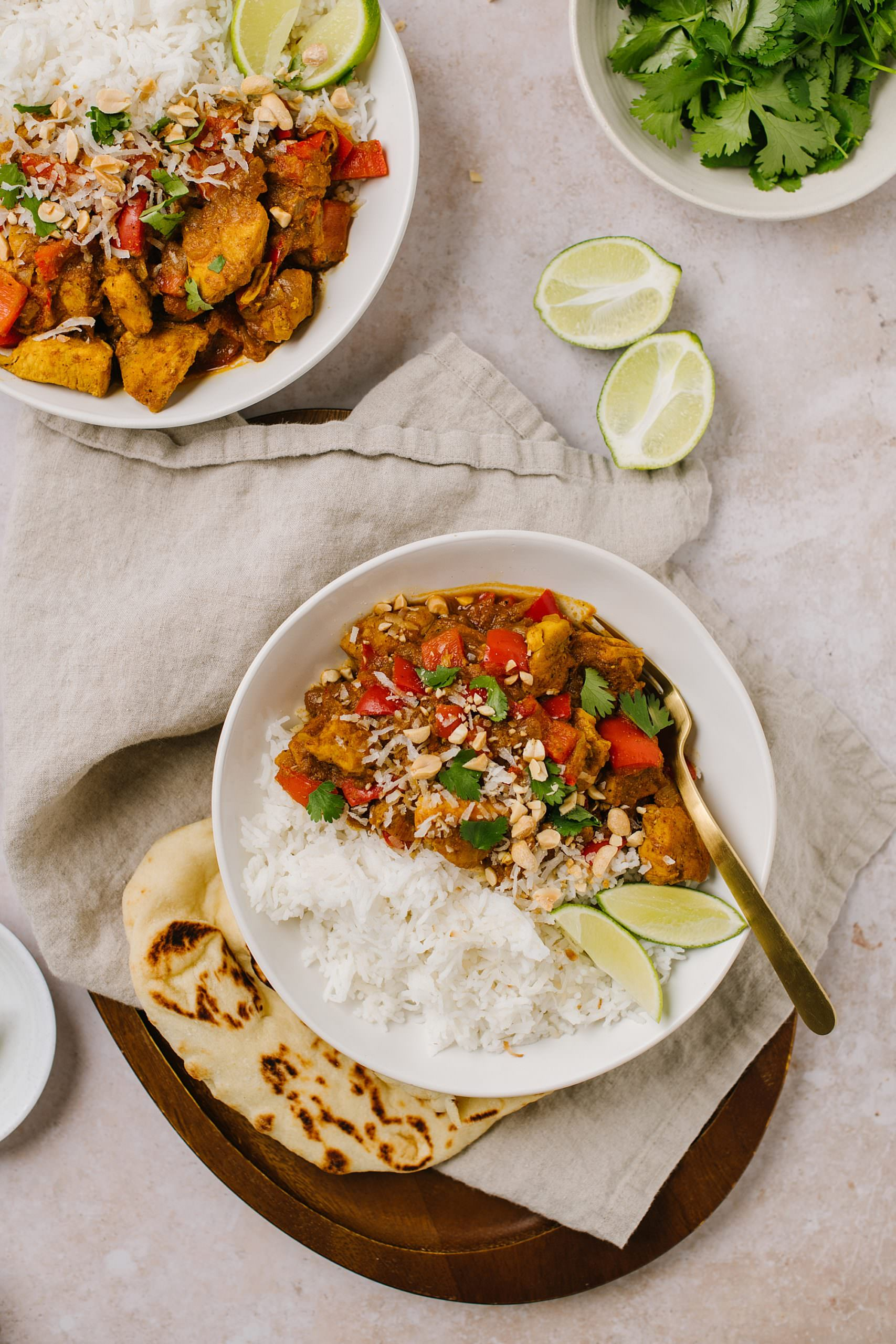 curry recipe with naan in a bowl with a spoon