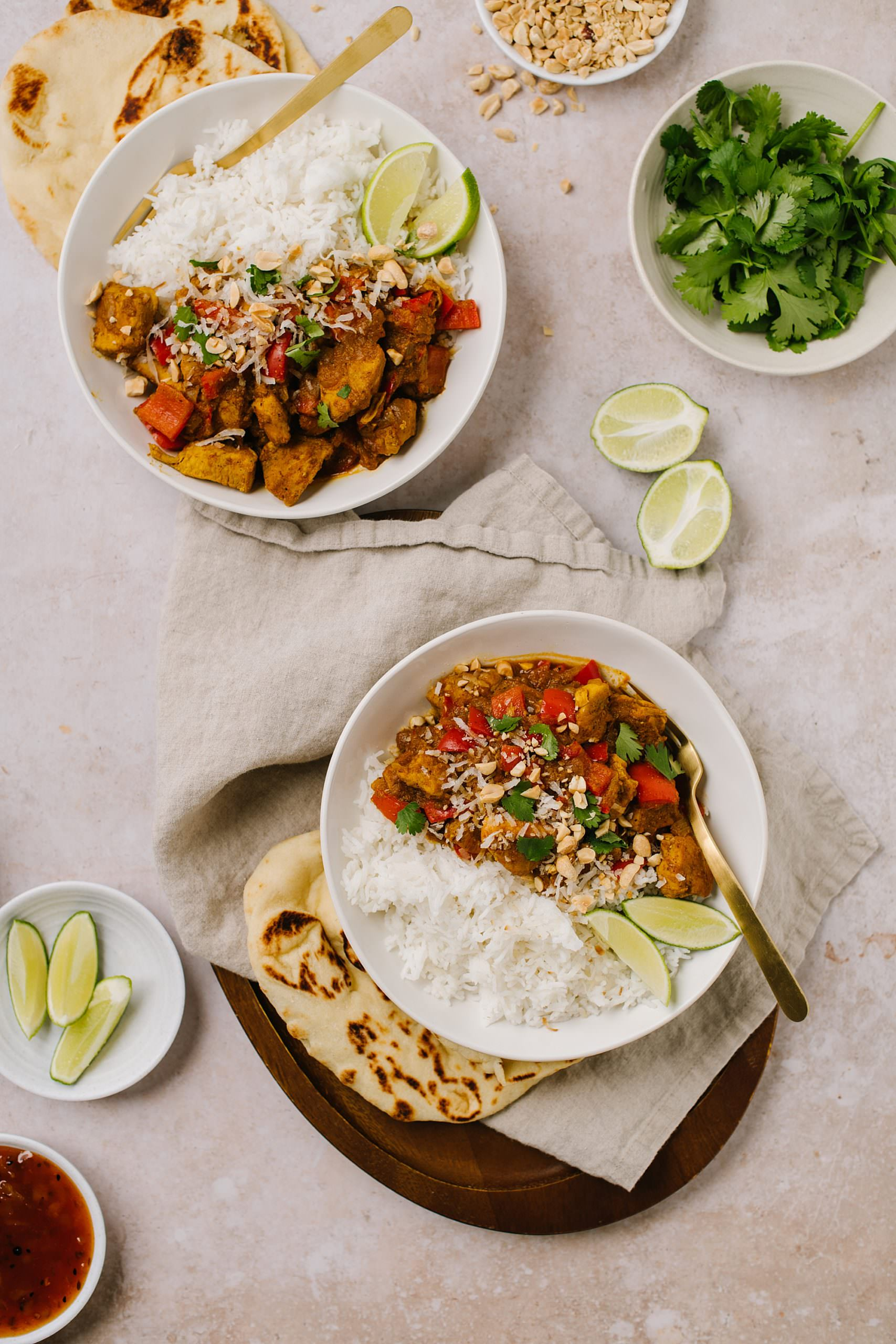Chicken Curry Recipe in bowls with rice with coconut and peanuts