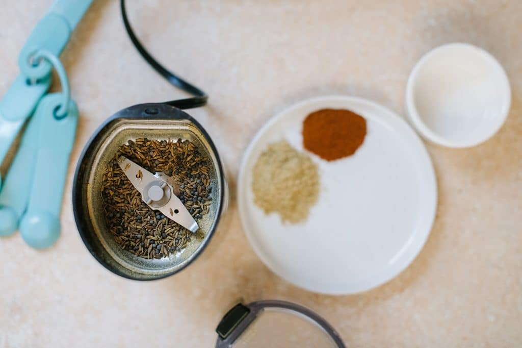 spices in a coffee grinder