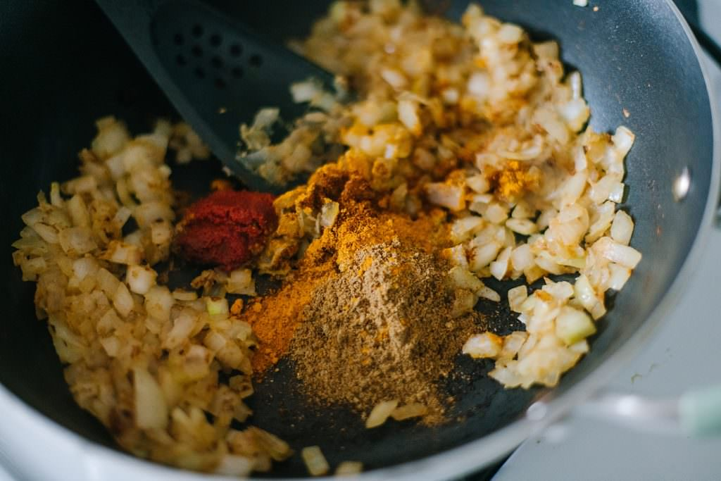 dry spices to fried onions