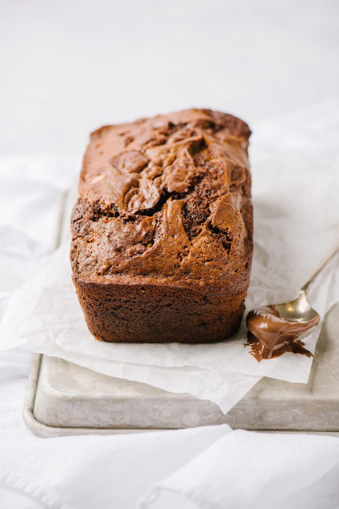 loaf of banana bread with spoonful of nutella