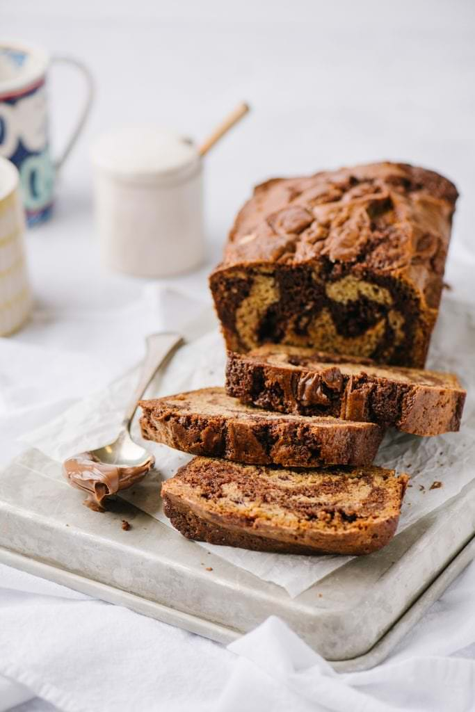 sliced banana loaf with nutella swirl and a spoon