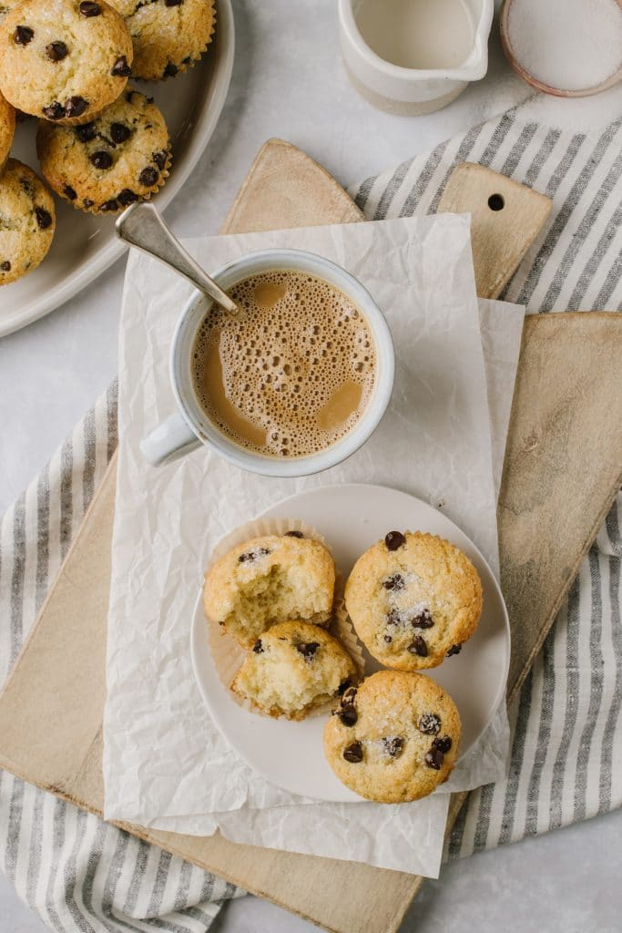 a cup of coffee with chocolate chip muffins