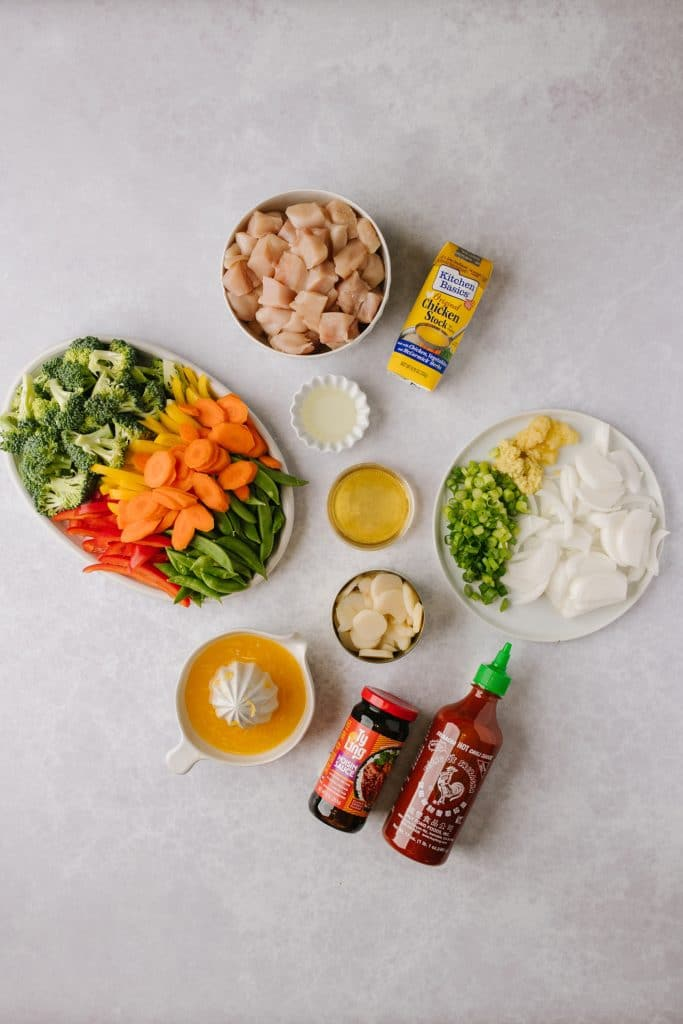 ingredients for healthier orange chicken and vegetables