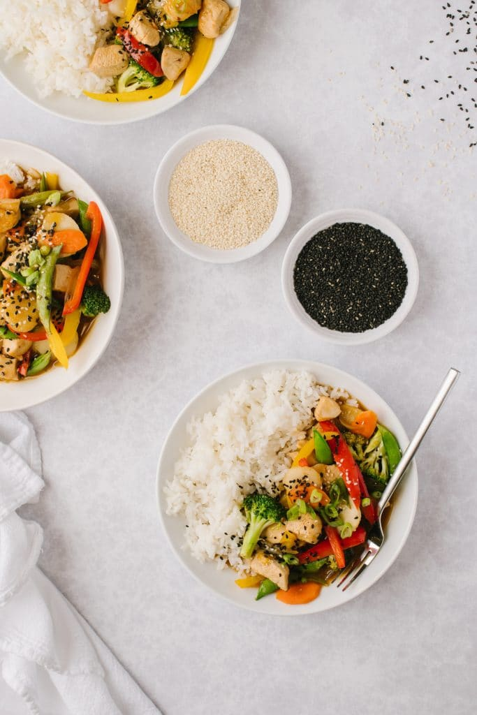 close up shot of healthy orange chicken and vegetable dish