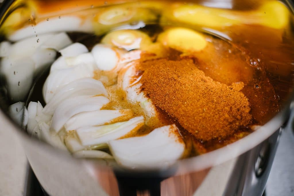 lemons, onions and Old Bay seasoning in large stockpot with water