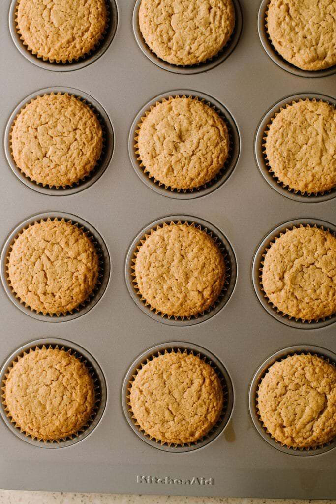 baked biscoff cupcakes in cupcake tin