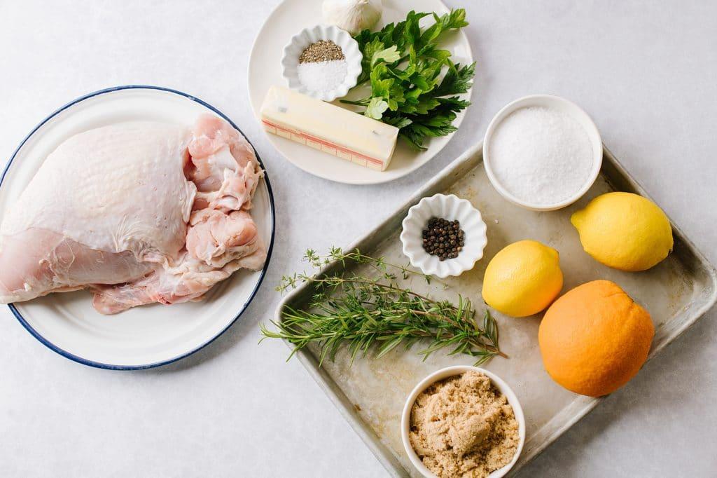 skin-on turkey breast, butter, salt, pepper, fresh herbs, peppercones, salt, sugar, oranges, lemon