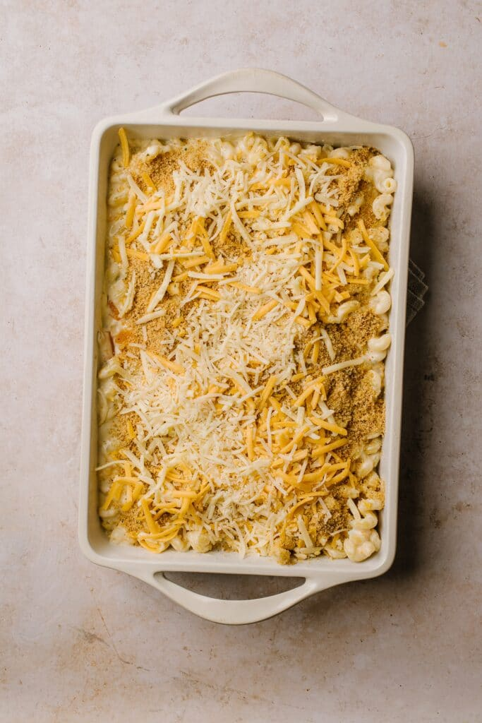 breadcrumb and cheese topped macaroni and cheese in white casserole dish