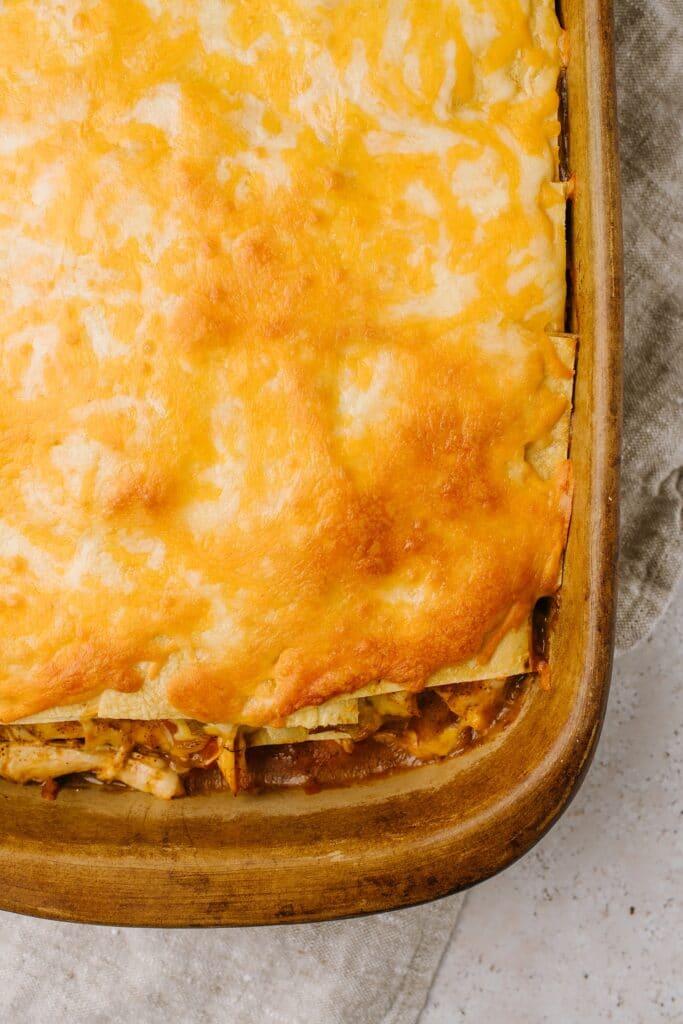 cheesy corn tortilla and chicken layer casserole in baking pan