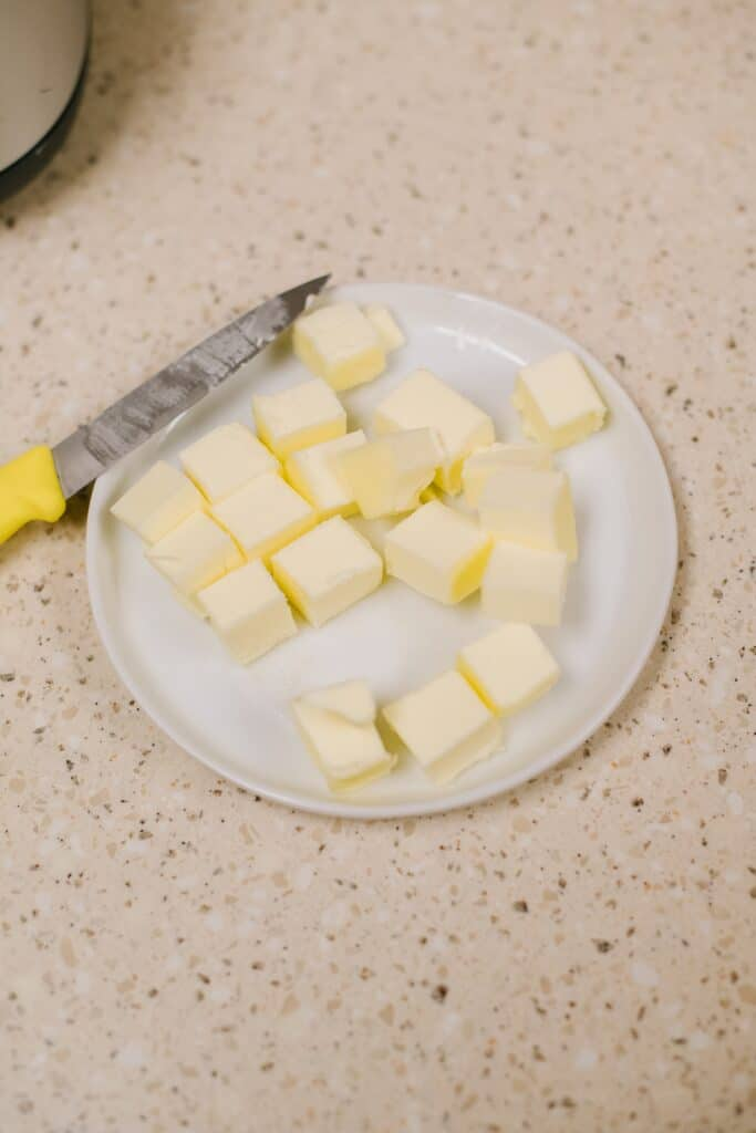 cubed butter on plate with knife