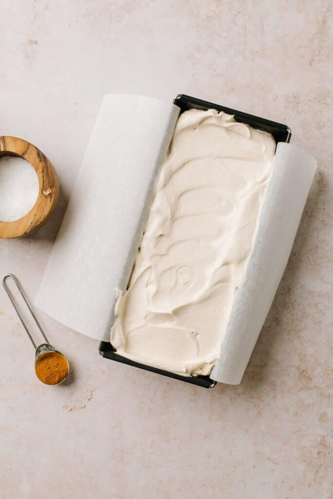 easy homemade ice cream in metal loaf pan with cinnamon and salt on side