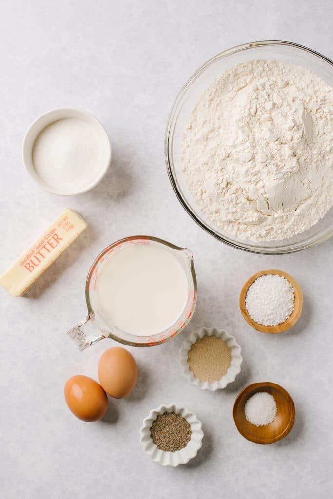 sugar. butter, milk, eggs, yeast, cardamom, pearl sugar, salt, flour