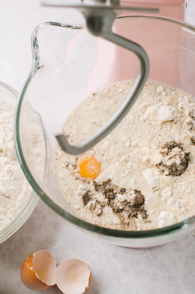flour, egg and ground cardamom in stand mixer with hook attachment
