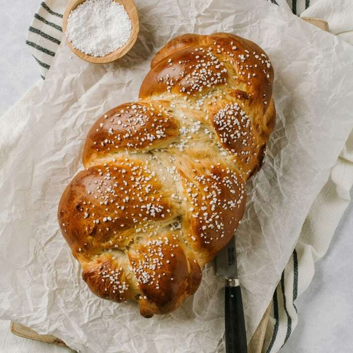 easy finnish pulla recipe with knife and pearl sugar on the side