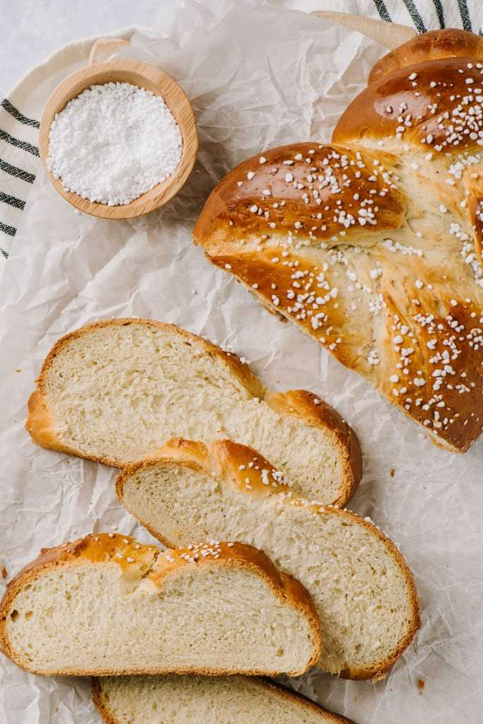 sliced finnish pulla with pearl sugar on the side