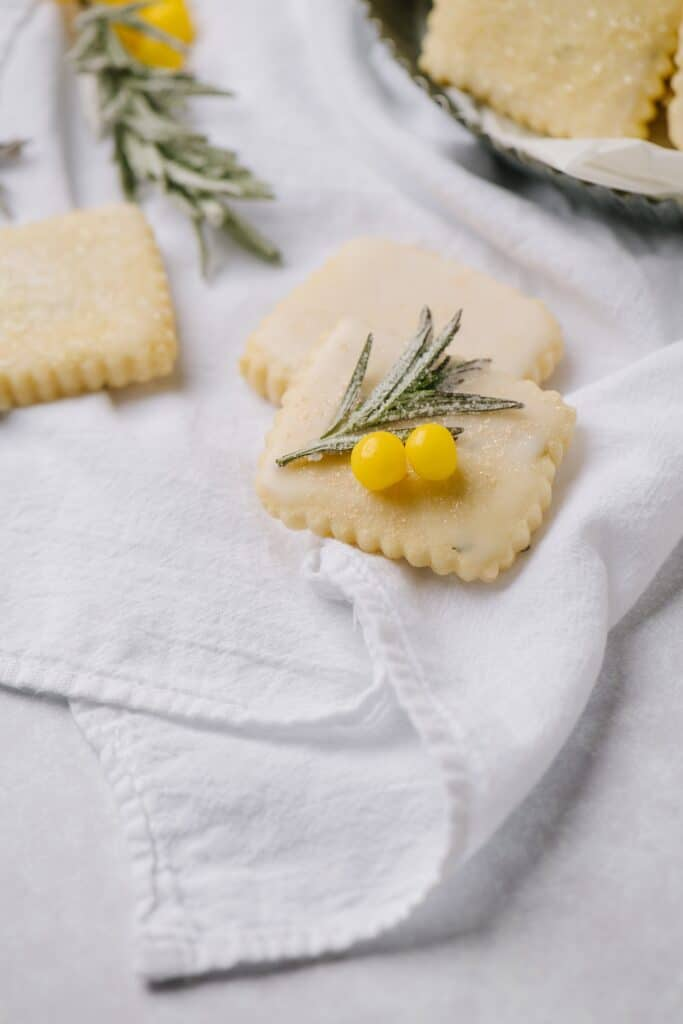 A close-up shot of freshly baked lemon rosemary cut out cookies