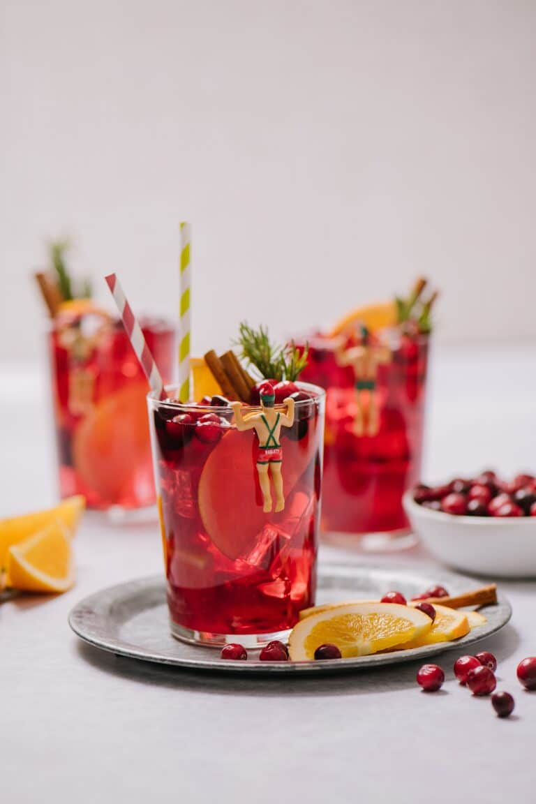 Glasses of mulled red wine sangria, with fruit and garnishes.