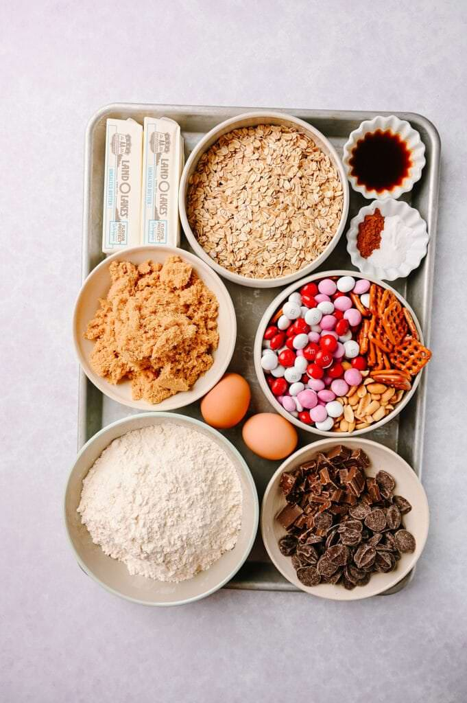 ingredients for making Salted Peanut Butter Pretzel Cowboy Cookies on a sheet pan