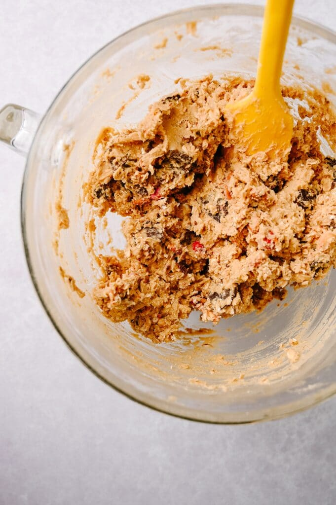 close bowl of batter for Salted Peanut Butter Pretzel Cowboy Cookies
