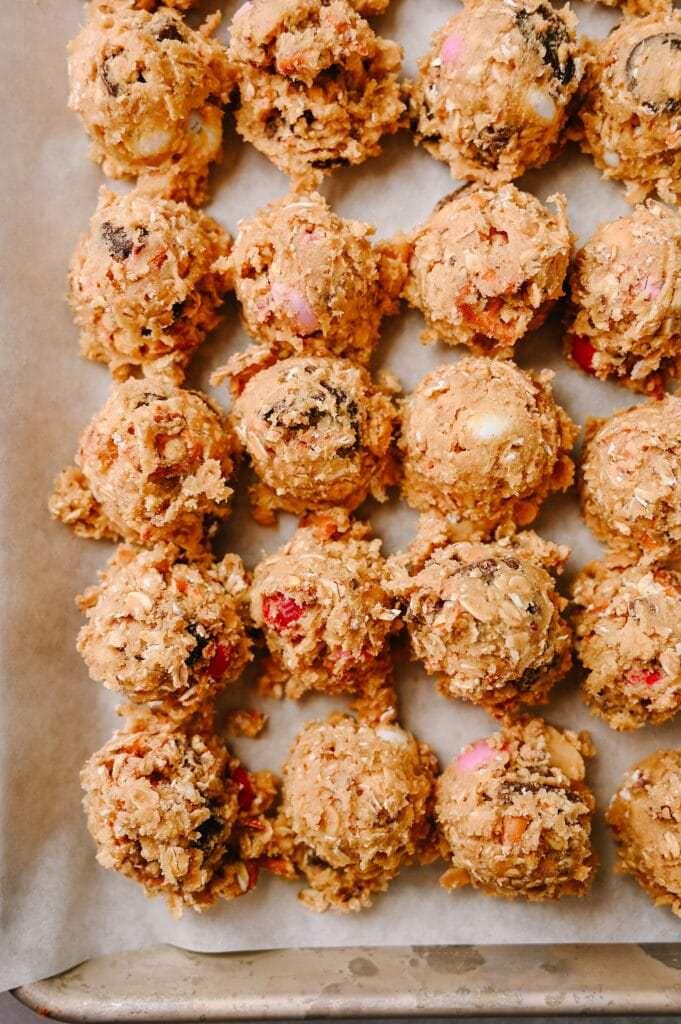 dough balls of Salted Peanut Butter Pretzel Cowboy Cookies