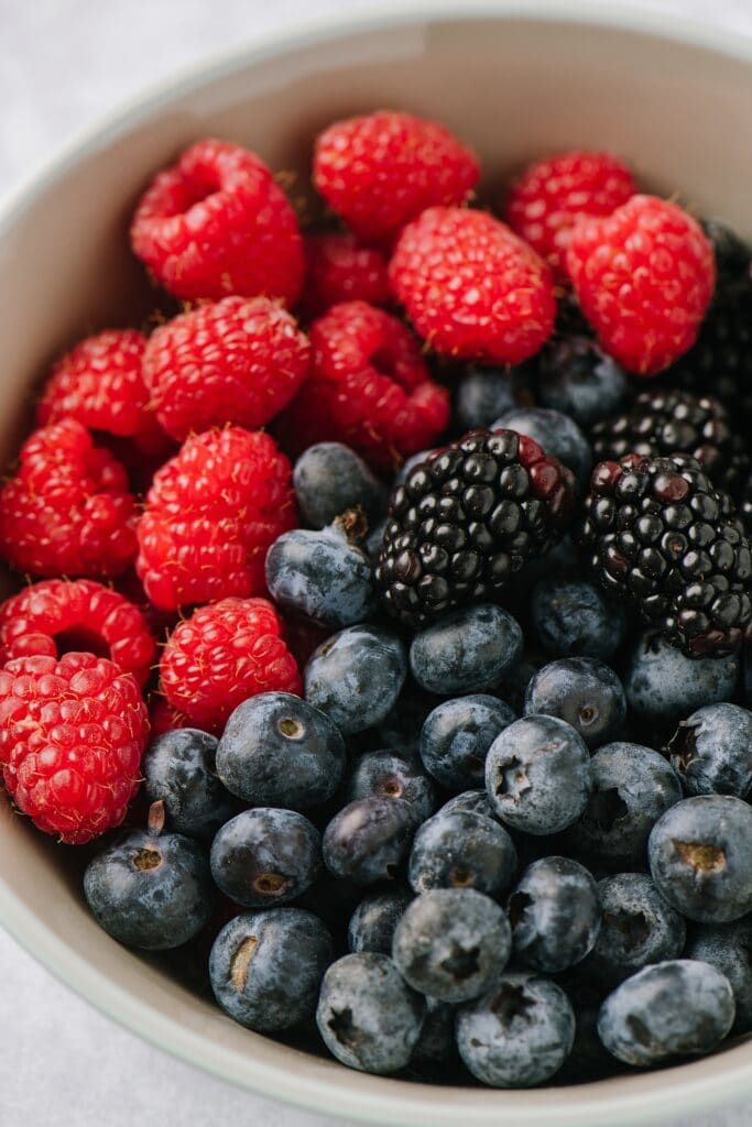 close up of bowl of raspberries, blueberries, and blackberries