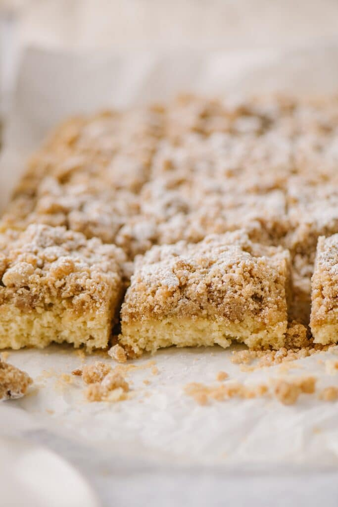 slices of new york crumb cake on a piece of parchment paper